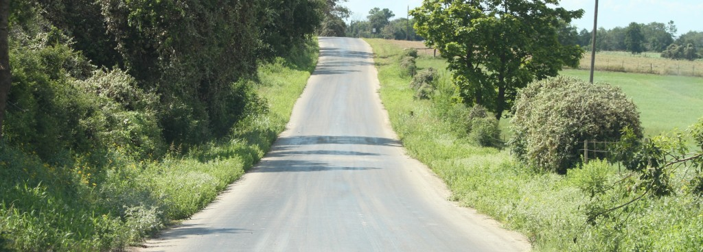 Road with soil stabilization product applied